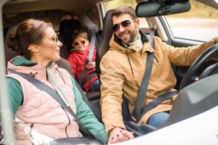 Photo for Happy friendly family travelling by car on rural road - Royalty Free Image