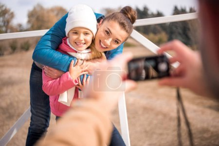 Happy mother hugging with little daughter