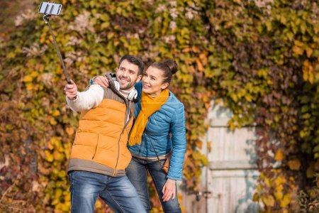 Photo for Beautiful smiling couple taking selfie at sunny autumn day - Royalty Free Image