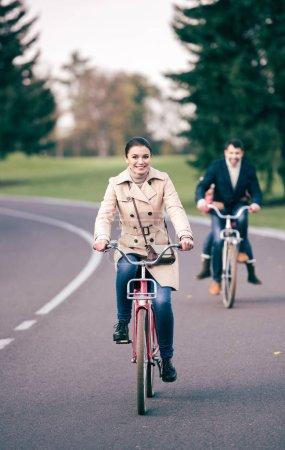 Beautiful smiling woman riding bicycle