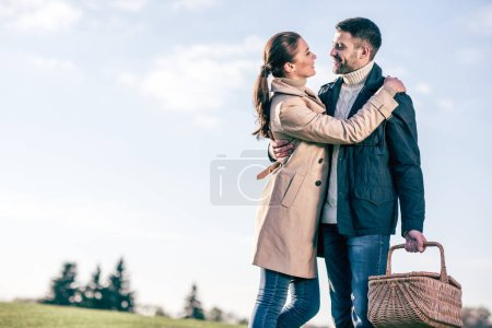 Happy couple with picnic basket