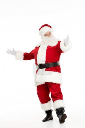 Photo pour Voir toute la longueur du père Noël posant avec la main tendue et gesticulant - image libre de droit