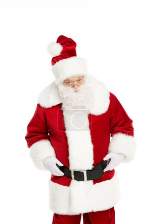 Photo for Three quarter length view of Santa Claus posing and gesturing isolated on white - Royalty Free Image