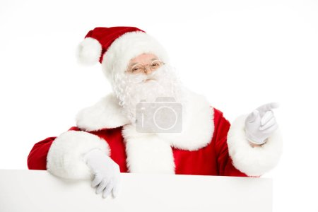 Photo for Santa Claus with blank white board, pointing his finger, isolated on white - Royalty Free Image
