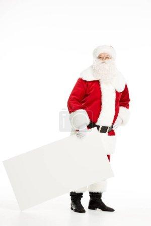 Photo pour Père Noël avec tableau blanc vierge à la main, isolé sur blanc - image libre de droit