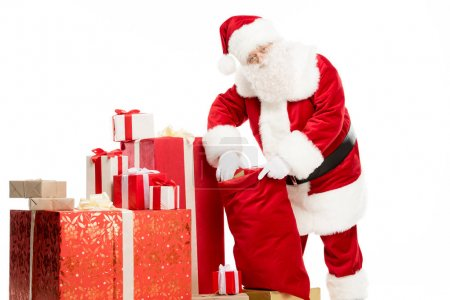 Santa Claus taking out Christmas gifts from sack