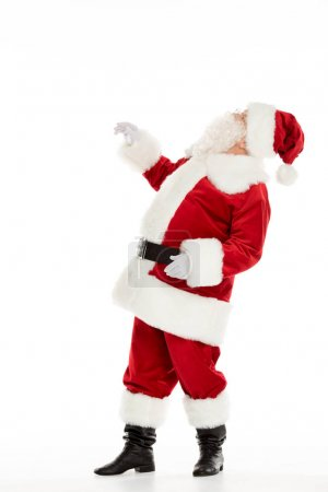 Photo for Side view of Santa Claus looking up isolated on white - Royalty Free Image