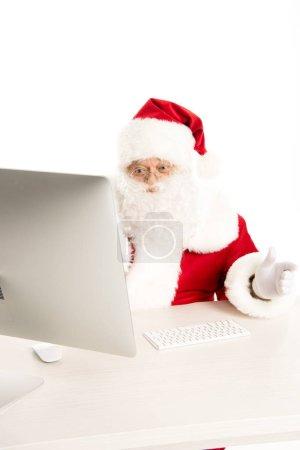 Santa Claus looking at computer
