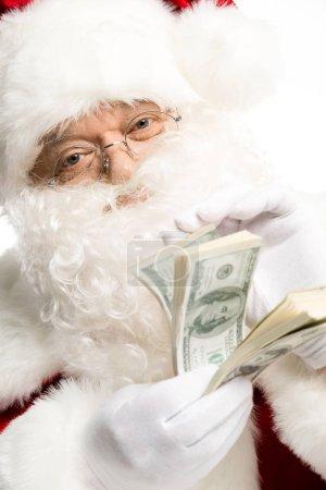 Santa Claus counting dollars