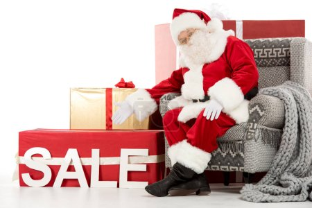 Santa Claus pointing on Sale sign