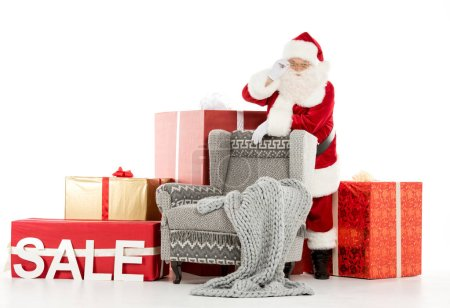 Happy Santa Claus with Sale sign