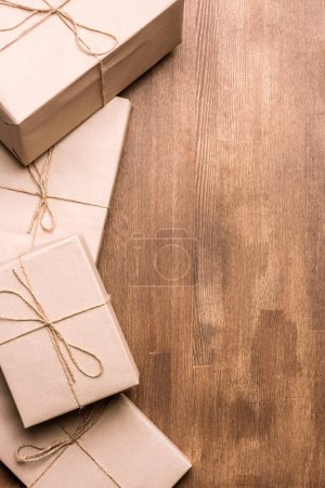 Photo for Pile of gift boxes on wooden background - Royalty Free Image