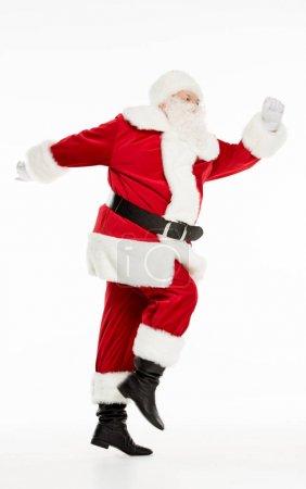 Happy Santa Claus during walk