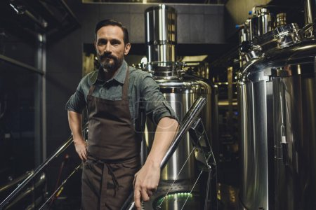 Photo for Male brewery worker in apron standing and looking at camera - Royalty Free Image