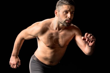 Photo for Muscular shirtless sportsman running - Royalty Free Image