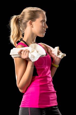 Sportswoman holding towel