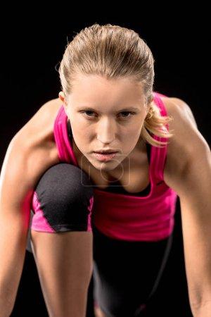 Photo pour Jogger féminin Sportswear en regardant la caméra - image libre de droit