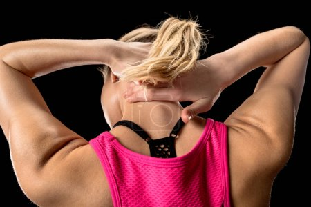 Photo for Back side view of tired sportive woman massaging her neck - Royalty Free Image