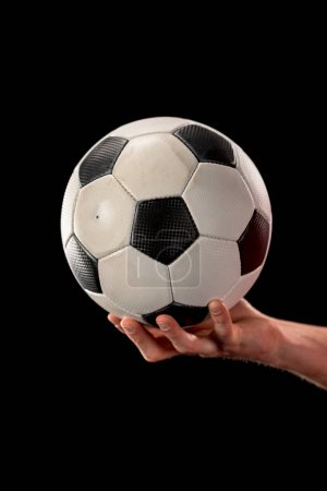Photo for Male hand holding soccer ball - Royalty Free Image