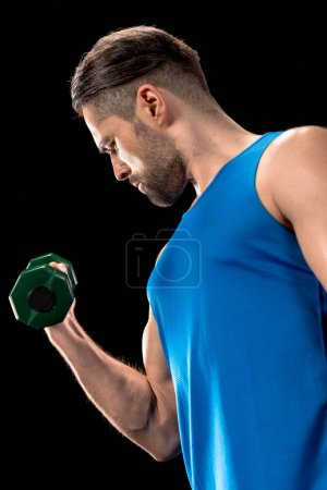 Photo for Sportive man doing bicep exercise with dumbbell - Royalty Free Image