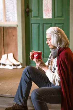 Woman holding cup of hot drink