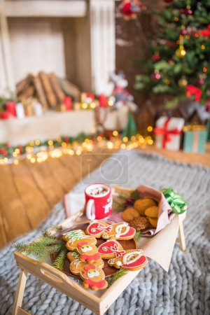 Photo for Wooden tray with christmas cookies and hot chocolate in cup on grey carpet - Royalty Free Image