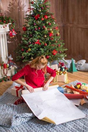 Girl wrapping gift box
