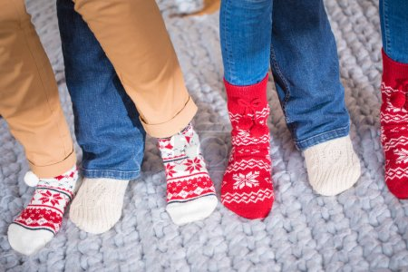 Photo for Close-up partial view of female feet in knitted socks - Royalty Free Image