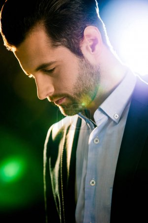 Photo for Close-up portrait of handsome bearded man in suit thoughtfully looking down - Royalty Free Image