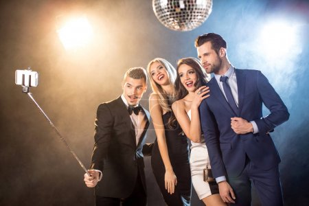 Photo for Happy stylish young friends taking selfie while celebrating in nightclub - Royalty Free Image