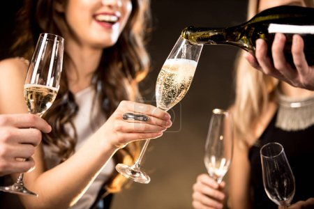 Photo for Partial view of happy young friends drinking champagne - Royalty Free Image