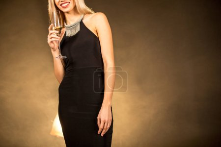 Woman holding champagne glass