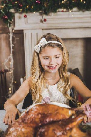 Cute girl at holiday table