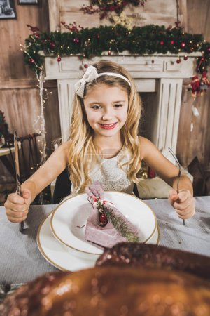 Cute girl at holiday table