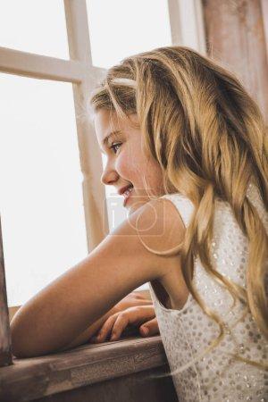 Cute girl looking at window