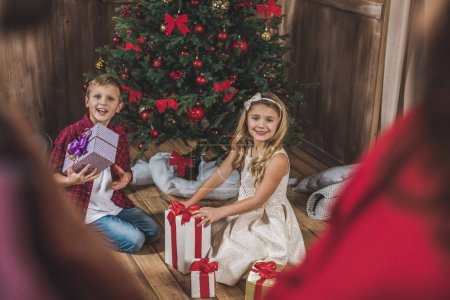 Children opening gift boxes