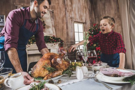 Father and son serving festive table