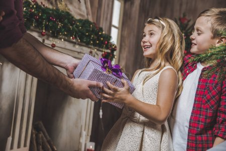 Girl receiving present