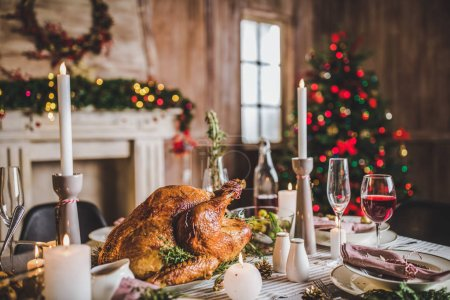 Photo for Delicious roasted turkey on served for Christmas table - Royalty Free Image