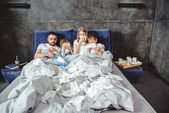 Sick family on bed