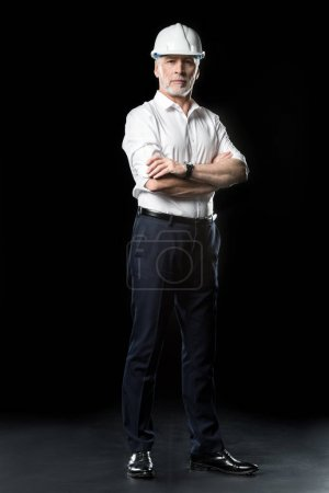 Photo pour Full length portrait of handsome mature male architect looking at camera  isolated on black - image libre de droit