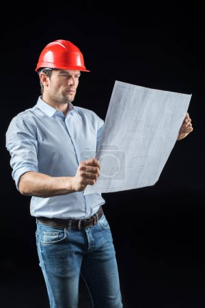 Male engineer with blueprint