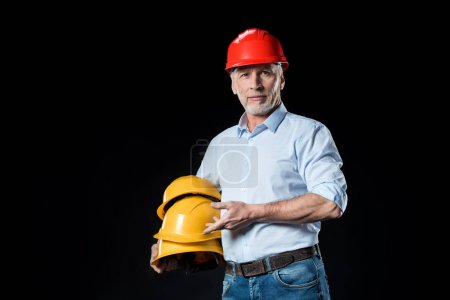Man holding hard hats