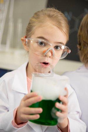 Schoolgirl holding flask