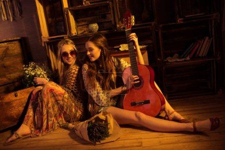 Bohemian women posing with guitar
