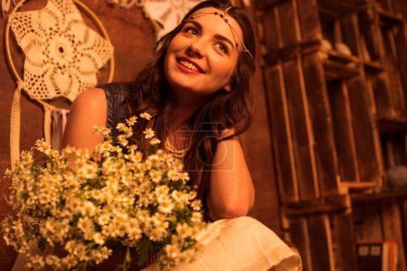 Bohemian woman with bouquet of flowers