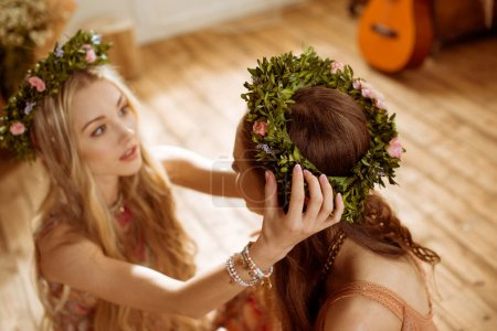 Women in boho style and wreaths