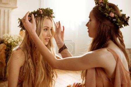 bohemian women in floral wreaths