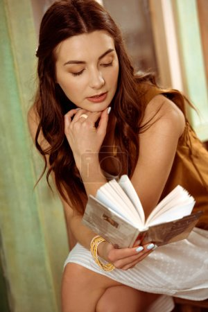 Bohemian woman reading book