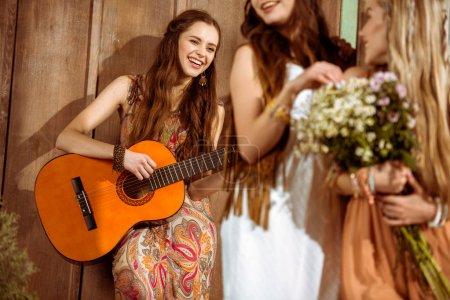 Bohemian woman playing guitar